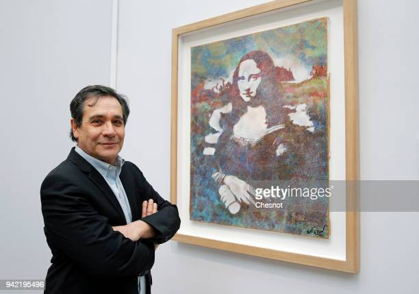 French street artist Blek Le Rat poses in front of his artwork representing Mona Lisa during the 2018 Art Paris Art Fair at the Grand Palais on April...