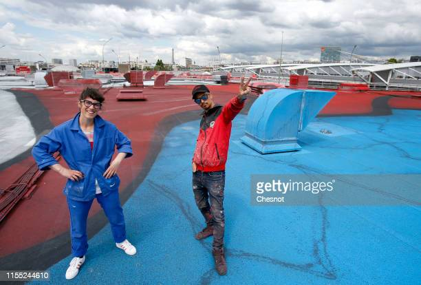 French street artists Ella and Pitr pose on the roof of Paris Expo Porte de Versailles on June 11 2019 in Paris France This work entitled What are we...