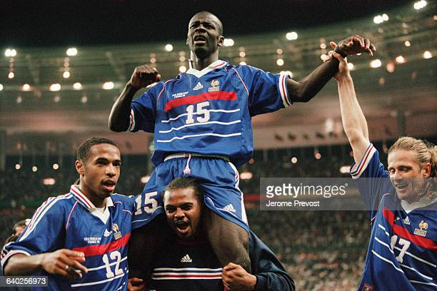 French striker Lilian Thuram celebrates with Thierry Henry Bernard Lama and Emmanuel Petit after France's victory over Croatia in the 1998 FIFA World...