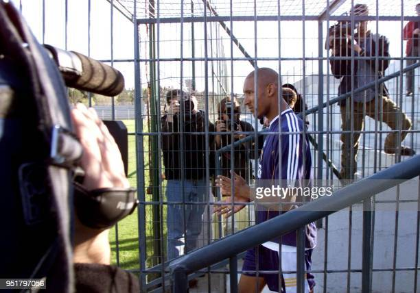 French striker of Real Madrid Nicolas Anelka arrives alone to train at Real Madrid sports center in Madrid 24 March 2000 Anelka asked the club for...