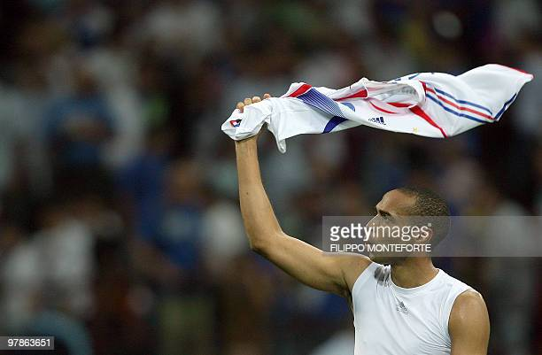 French striker Thierry Henry waves his jersey to the fans at the end their Euro 2008 qualifier football match Italy vs France in Milan's San Siro...
