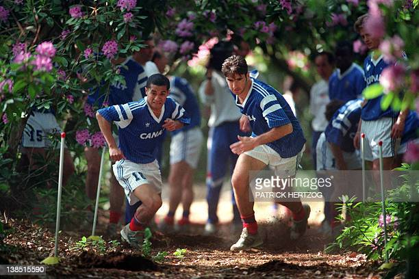 French strikers Pascal Vahirua of Auxerre and Eric Cantona of Leeds run on May 25, 1992 in Clairefontaine during a team training for the forthcoming...