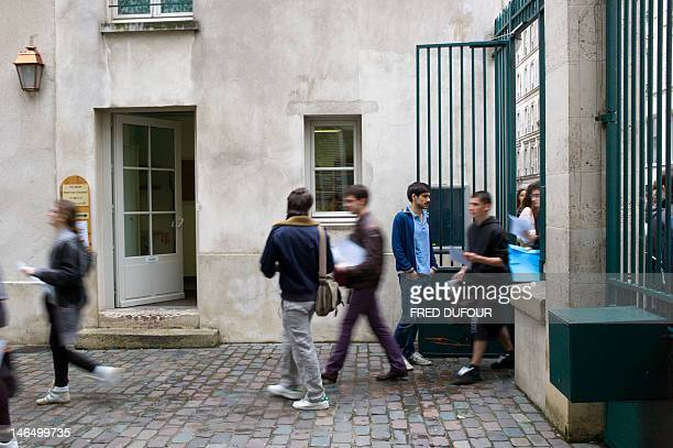 French students arrive to work on the test of Philosophy as part of the baccalaureat exam on June 18 2012 at the Lavoisier high school in Paris Some...