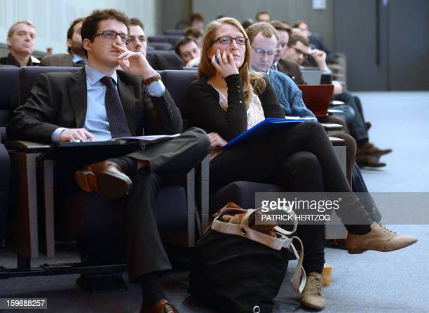 SIMON French students Clement Robert and Marie Argouarch listen to a teaching staff member in a conference room of the Ecole Nationale...