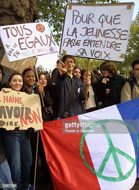 French students demonstrate against farright presidential candidate JeanMarie Le Pen April 29 2002 in Paris Le Pen will face incumbent Jacques Chirac...