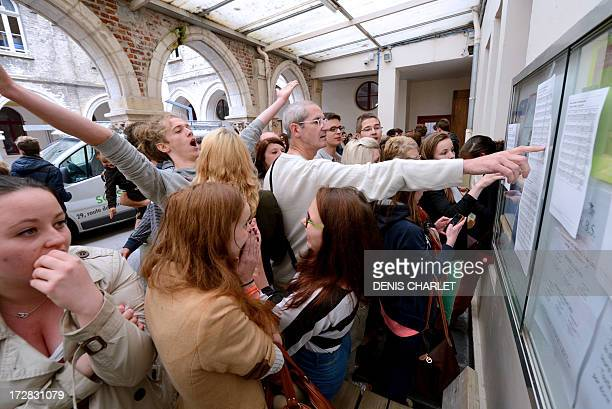 French students react after viewing the results of the professional baccalaureat exam , on July 5, 2013 at the Saint-Denis high school in Saint-Omer,...