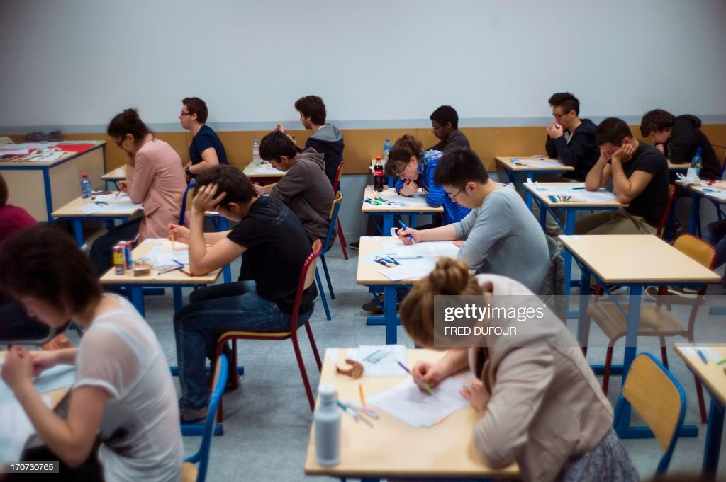 French students work on the test of philosophy as they take
