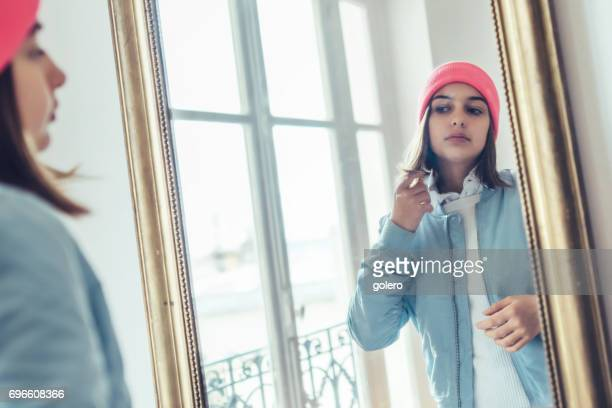 french stylish teenage girl looking herself in  mirror - girl in mirror stock photos and pictures