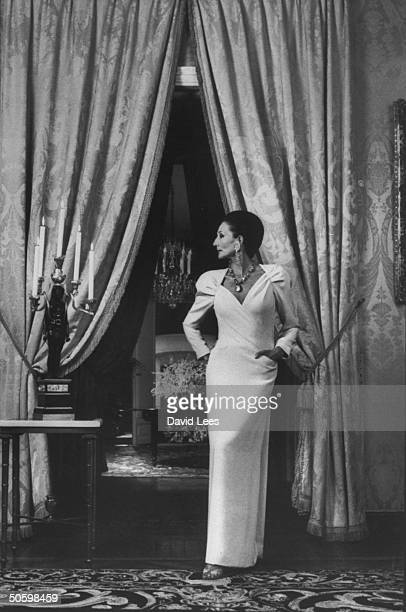 French stylist and socialite Viscountess Jacqueline de Ribes wearing evening dress and posing in ornate salon