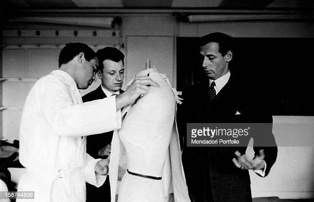 French stylist Marc Bohan director of the fashion house Dior watching a tailor working 1960s