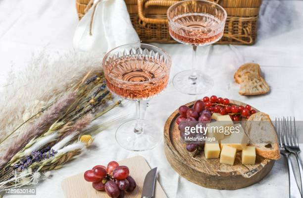 french summer picnic with rose wine and cheese - wine stock pictures, royalty-free photos & images