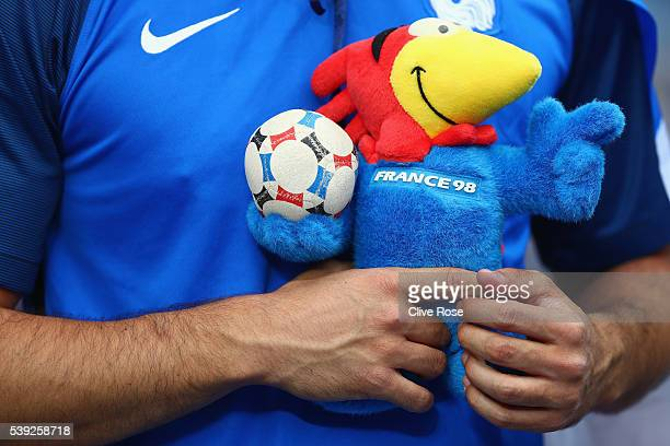 French supporter holding the soft toy of Footix mascot of 1998 FIFA World Cup is seen prior to the UEFA Euro 2016 Group A match between France and...