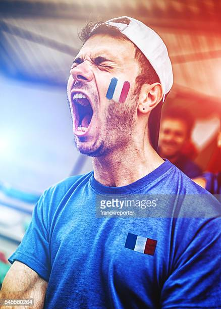 french supporters at stadium cheering - fan enthusiast stock photos and pictures