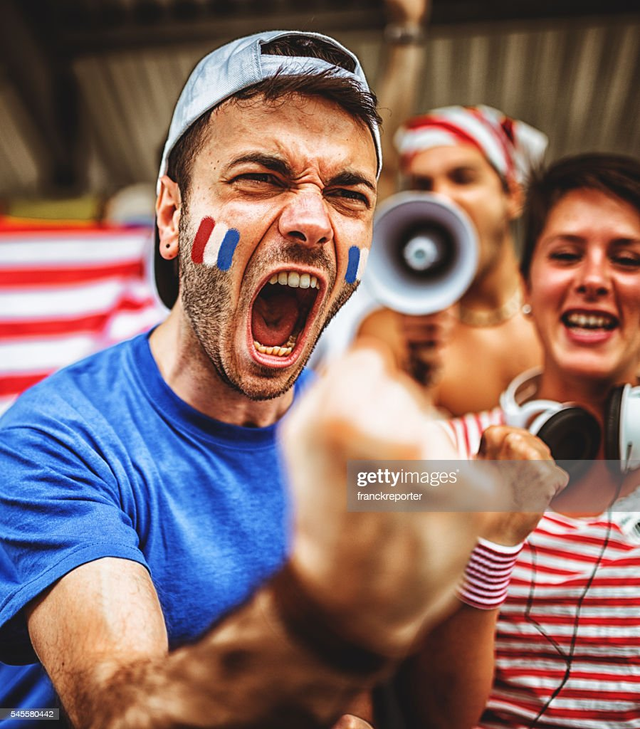 french supporters at stadium cheering : Stock Photo