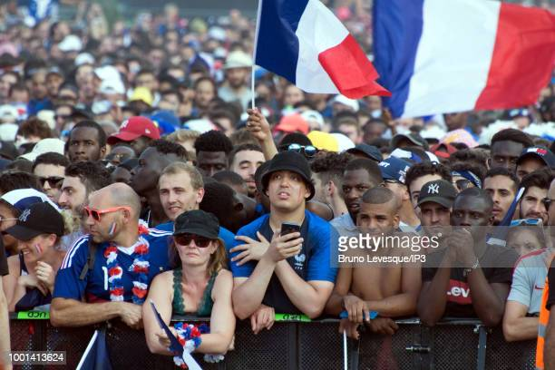 French supporters at the Champs de Mars for watching the final of the 2018 Football World Cup between France and Croatia on a giant screen on July 15...