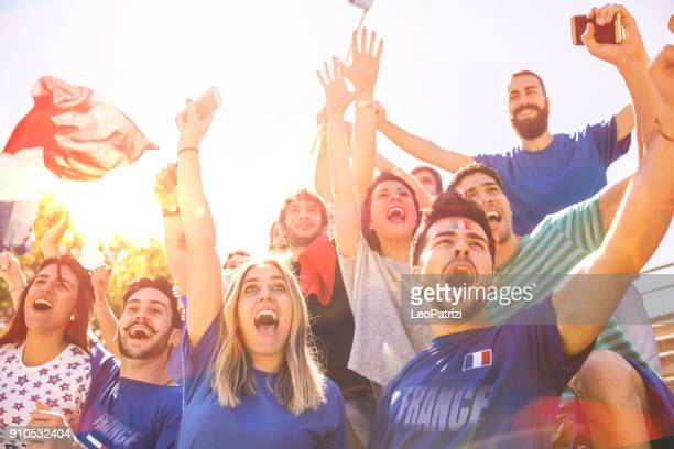 french supporters at the football league supporting their national team - france stock pictures, royalty-free photos & images