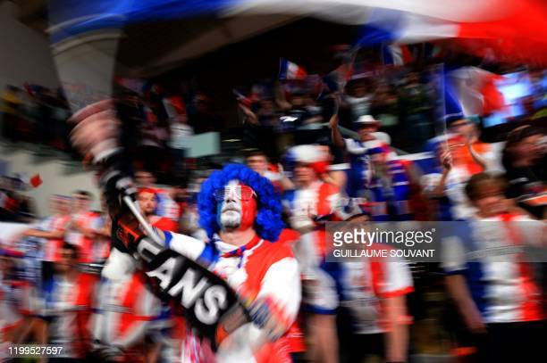 French supporters attend the FIBA Women's Olympic Qualifying Tournament match between France and Brazil on February 8 at the Prado stadium in Bourges...