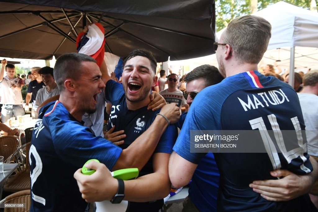french supporters celebrate their team s victory at the end of the