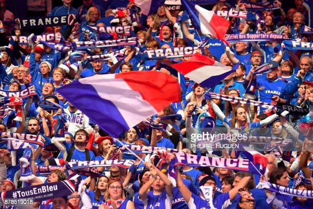French supporters cheer during the match between Belgium's Steve Darcis and France's Jo-Wilfried Tsonga during their singles rubber of the Davis Cup...