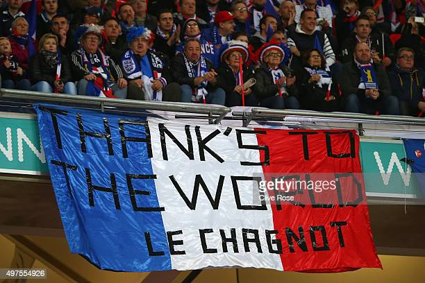 French supporters hold a banner to appreciate the support following the terror attack in Paris prior to the International Friendly match between...