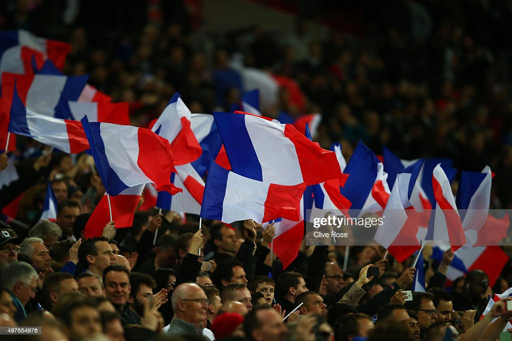 French supporters wave the national flags prior to the International Friendly match between England and France at Wembley Stadium on November 17, 2015 in London, England.