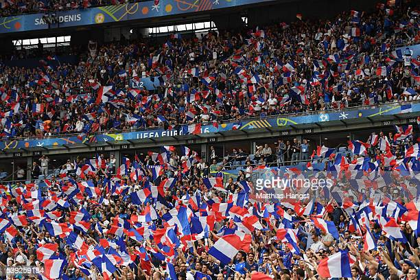 French supporters wave the national flags prior to the UEFA Euro 2016 Group A match between France and Romania at Stade de France on June 10 2016 in...