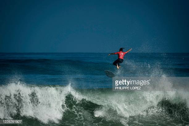 French surfer Johanne Defay exits a wave as she competes in the final round of the French Federation Cup in Hossegor on July 7 2020