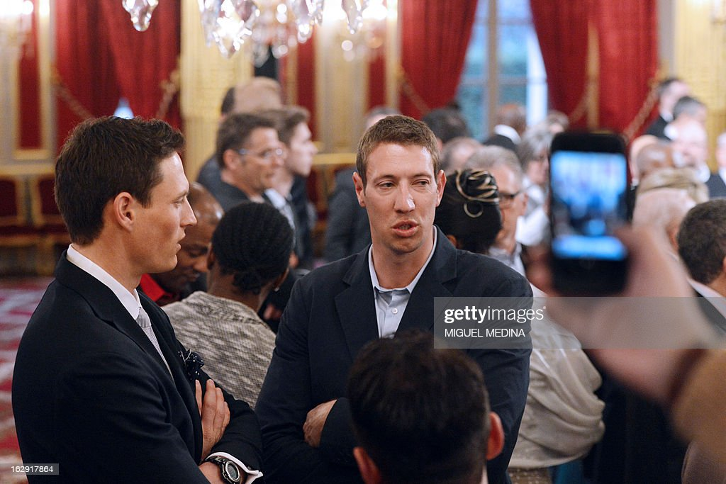 French swimmer Alain Bernard (C), gold medalist at the 2012 London olympics games, waits to be awarded by French Legion d'Honneur during a ceremony on March 1, 2013 in Paris.