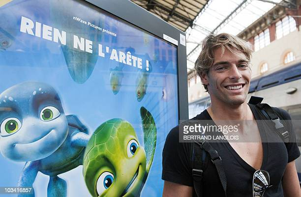 4a738fe633d1 French swimmer and European gold medalist Camille Lacourt speaks with  journalists at Marseille SaintCharles train station