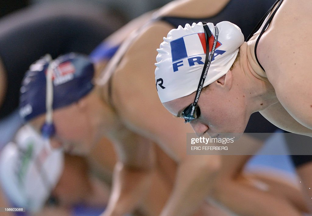 French swimmer Camille Muffat (R) takes the start of the women's 200m freestyle series at the European short course Swimming Championships on November 25, 2012, in Chartres.