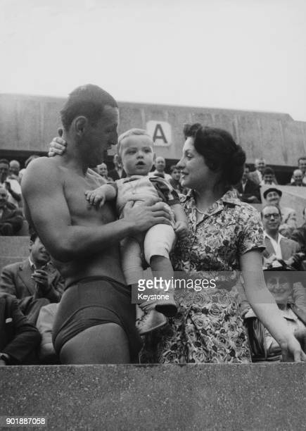 French swimmer Jean Boiteux is congratulated by his wife and son after winning the 1500 metre and setting a European record at the French swimming...