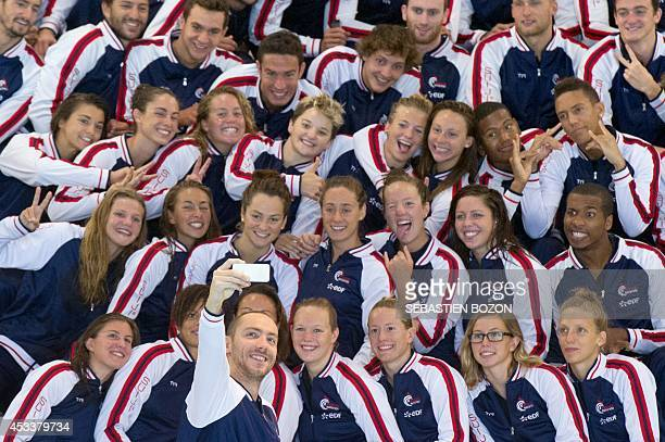 French swimmer Jeremy Stravius takes a selfie with his teammates during the French team training session in Mulhouse, eastern France, on August 9...