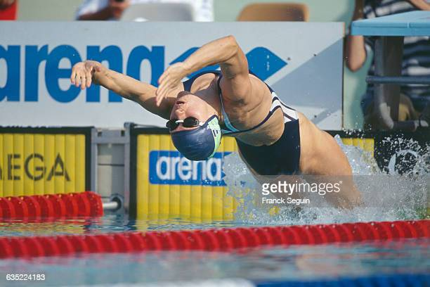 French swimmer Roxana Maracineanu launches backwards from the starting block of the women's 200meter backstroke during the Canet's meeting