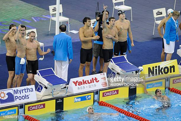 French swimmers Yannick Agnel Gregory Mallet Jeremy Stravius US swimmer Richard Berens Michael Phelps and Peter Vanderkaay react during the final of...