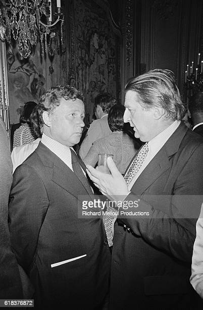 French talk show host Philippe Bouvard and journalist Marcel Jullian attend a garden party in honor of Francophone members of the European Parliament...