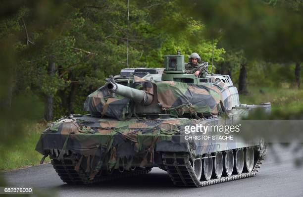 French tank soldier drives at a tank type 'Leclerc' after the friendship shooting of several nations during the exercise 'Strong Europe Tank...
