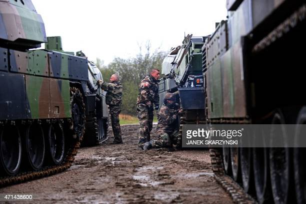 French tanks are unloaded from a train in Drawsko Pomorskie northern Poland on April 28 2015 Fifteen French tanks and 270 soldiers come to Drawsko...
