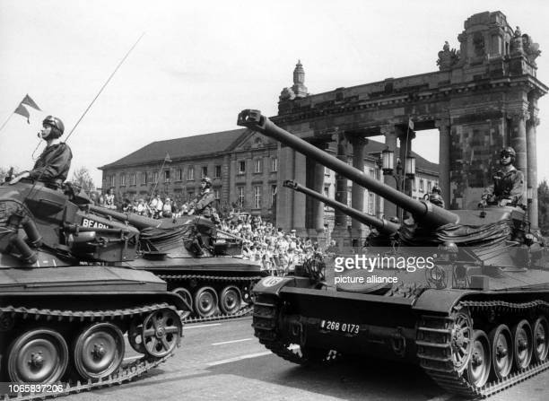 French tanks driving past the Charlottenburger Tor in Berlin during the final rehearsal for the parade on occasion of the 'Armed Forces Day' on 14th...
