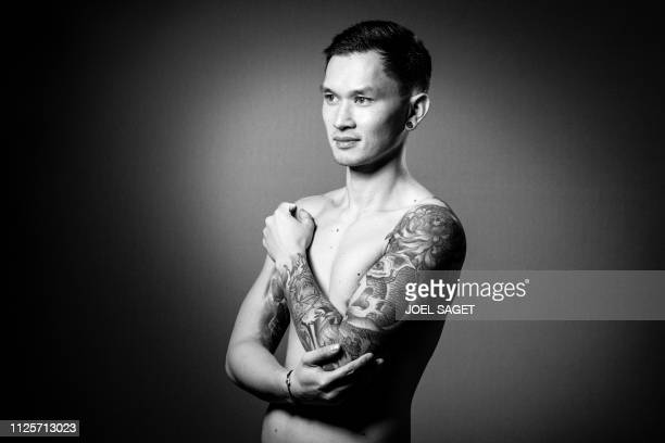 8bb230cf15394 French tattoo artist Michael Taguet poses during a photo session on  February 15 2019 at the