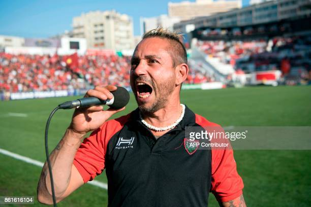 French tattoo maker and singer Cedric Abellon performs the traditional song of the RCT fans Pilou Pilou prior to the Champions Cup rugby union match...