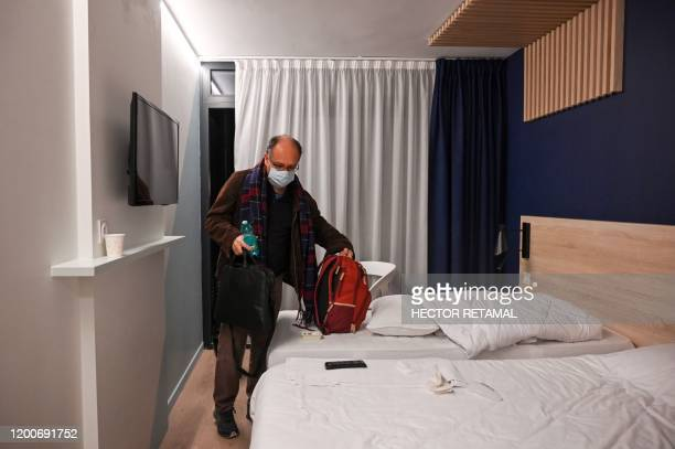 French teacher Vincent Lamarie leaves his room as he and other French citizens depart from The Vacanciel Holiday Resort in CarryleRouet near...