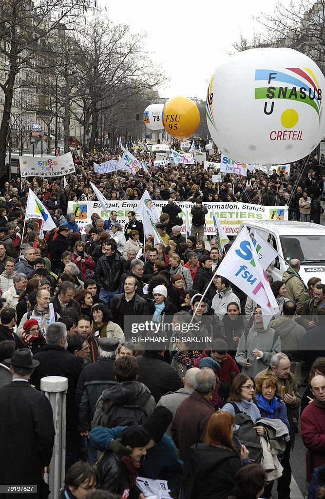 French teachers and other public service employees demonstrate to protest against jobs cuts and low wages, 24 January 2008 in Paris. Seven of the eight unions representing France's 5.2 million state employees called for the one-day strike and protest marches in Paris and other cities.