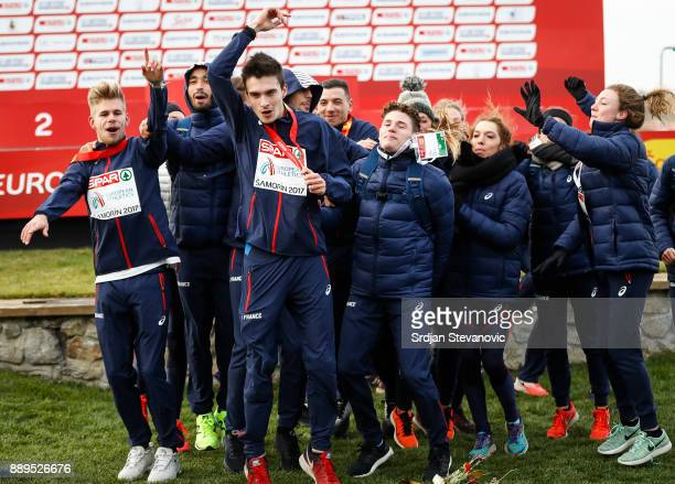 French team celebrate their Gold Medal with team mates during the U23 Men's award ceremony during the SPAR European Cross Country Championships on...
