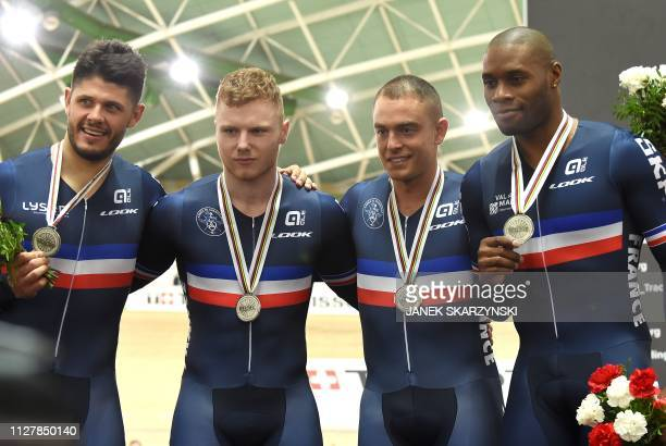 French team Gregory Bauge Quentin Lafargue Sebastien Vigier and Michael D'Almeida react at the podium after winning silver in the men's team sprint...