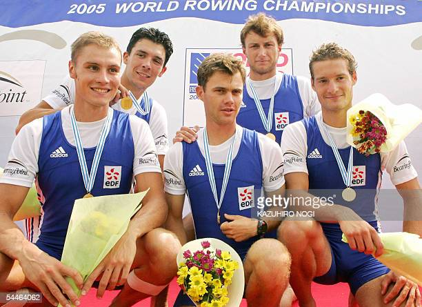 French team LR Jonatan Mathis Lionel Jacquiot Nicolas Majerus Vincent Durupt Nicolas Podpovitny pose for a photograph during the award ceremony for...