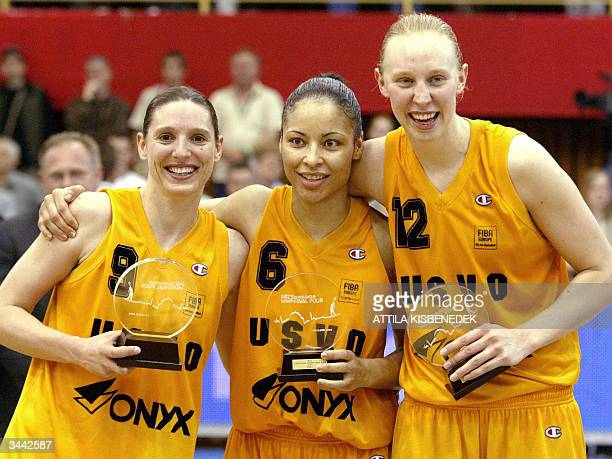 French team players Audrey Sauret Allison Feaster and Ann Wauters of US Valenciennes Olympic celebrate their victory against Polish Lotos VBW Clima...