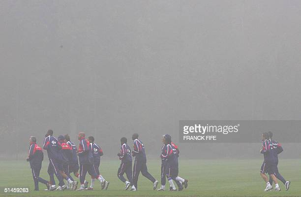 French team runs 07 October 2004 during a training session in Clairefontaine, outside Paris. France will play Cyprus in Larnaca 13 October 2004 in...