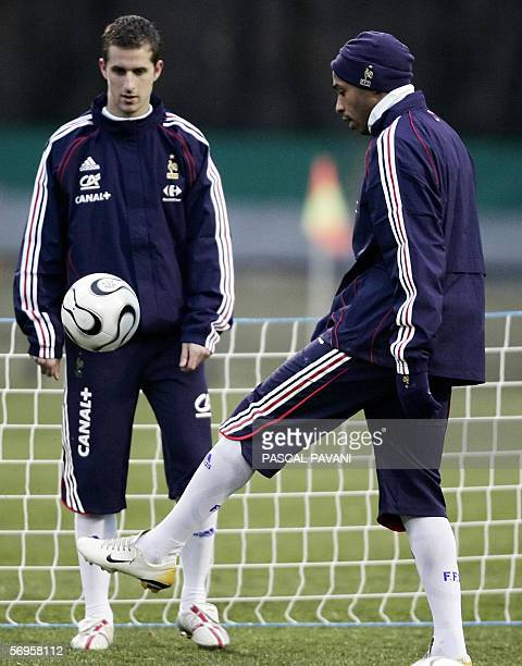 French teammate Thierry Henry and Francois Clerc practice during a training session 27 February 2006 in the French football National Center of...