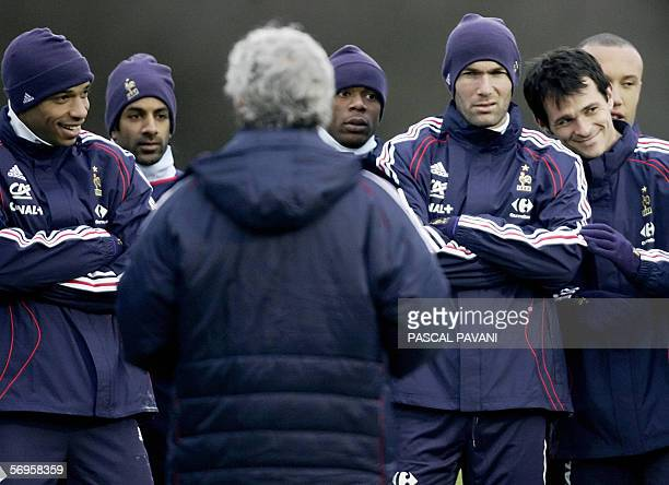French teammate Thierry Henry Vikash Dhorasoo Sylvain Wiltord Zinedine Zidane Willy Sagnol and Mikal Silvestre listen to France's team head coach...