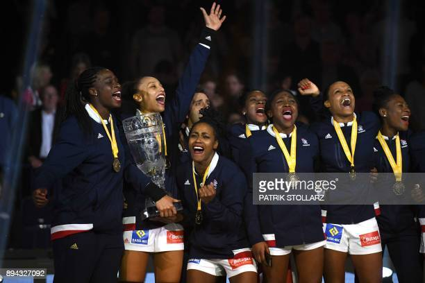 French team's, Orlane Kanor , Laurisa Landre , Allison Pineau and teammates celebrate after France won the IHF Womens World Championship handball...